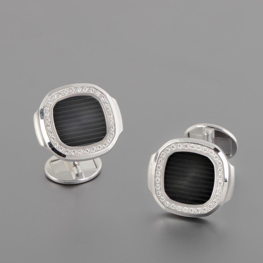 A Pair of Patek Philippe Nautilus White Gold and Diamond Cufflinks