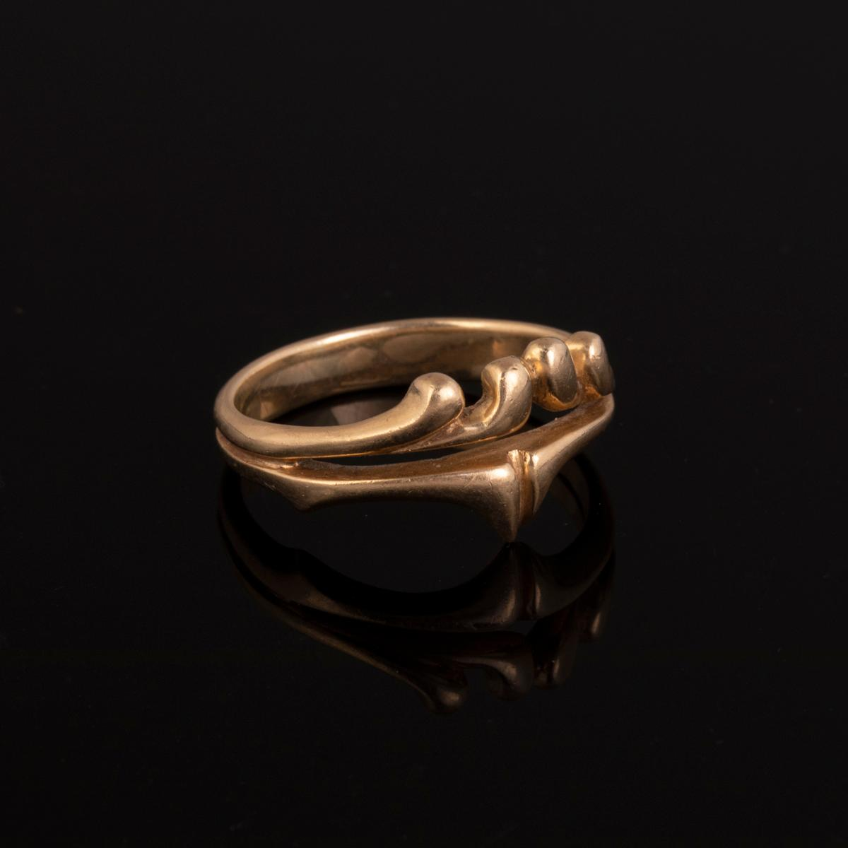 A Gold Wave Form Ring