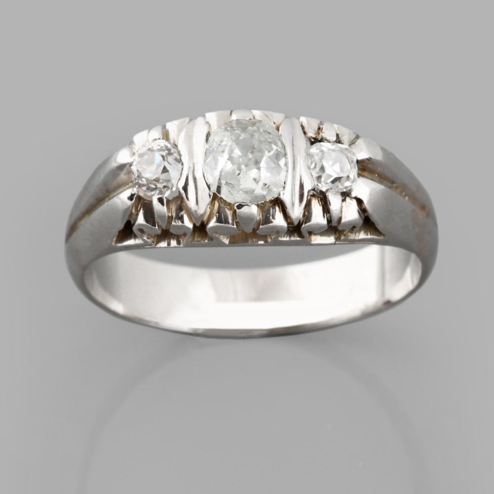 White gold ring set with three diamonds