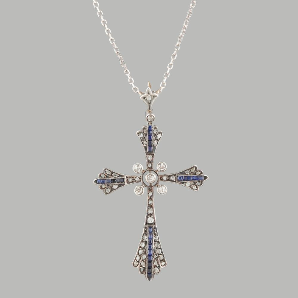 Silver and gold cross set with 49 diamonds and 24 sapphires, with silver thread