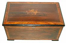 Music box, ebonized case with Brazilian rosewood veneer, tulipwood cross banding and light wood line inlay, the center of the top with inlaid marquetry musical trophy, inside of lid with birds eye figured veneer panel and large lithographed tune