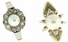 Rings- 2(Two), one with a 7 1/2mm pearl flanked by two small diamonds, set in white gold, marked 14k, size 6 1/2, the other with a 5 3/4mm pearl surrounded by ten small diamonds, set in 14k yellow and platinum, size 8, 9.3g TW