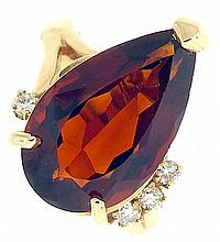 Ring, 9 carat pear shape red citrine with four accent diamonds set in yellow gold, marked 14k, size 6, 5.9g TW