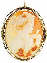 Cameo pin /pendant, carved shell portrait of a young woman in profile, 14 karat yellow gold oval frame with filigree and foliate ornament, 1 3/4
