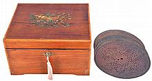 Music Box- German, Monopol 30 note single-comb disc music box in striped mahogany case playing size No. 130; (7.5in) edge-drive discs. The music box comes with 4 (Four) discs including: