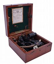 Sextant- Boxed sextant by Henry Hughes & Sons of London. WWII-era English marine instrument with black finish in original finger-jointed box with brass hardware. Inside of box has framed