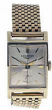 Longines, Switzerland, man's gold wrist watch, 17 jewels, manual winding nickel plate movement with lever escapement in a 14 karat, yellow gold, case and bracelet, baton marker metal dial and gilt dauphine hands, serial #7799300, 22mm x 37mm, 45.3g