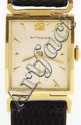 Wittnauer, Switzerland, man's wrist watch, 17 jewels, manual winding, nickel plate movement, with lever escapement in a 14 karat, yellow gold, snap back case, with Arabic numeral metal dial, and lizard strap 19.4g TW