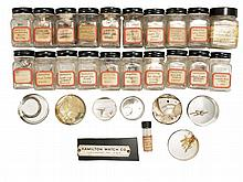 Hamilton 21 marine chronometer parts, including fusee click springs, balance cap jewels, hour, minute, and wind indicator hands, bowl screws, maintaining power pawl, dust guards, fusee top and end plate, detents, shutter springs, chain hooks, balance