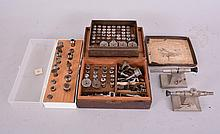 Watchmaker's Lathe Collets and Tailstocks: lot includes two lathe tailstocks (possibly Boley), more than seventy 8mm wire or split chucks, six step chucks, five balance chucks, and some wax chucks. Makers include Victor, Whitcomb, Boley, Starrett,