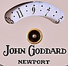 The Henry Ford Museum, Dearborn, Michigan reproduction John Goddard, Newport, Rhode Island, tall case clock, 8 day, time, strike and triple chime, weight driven movement in a mahogany case with five wooden finials, carved rosettes, fluted full