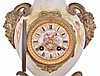 France, mantel clock, the vase form porcelain case with painted putti flanking the dial, satyr mask handles, the top with flowers and a pair of birds, all on a gilt base with foliate ornament, porcelain dial with Roman numerals, gilding, and central