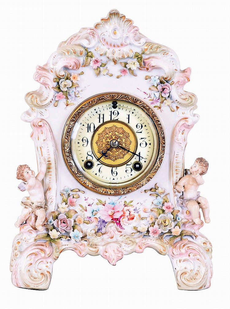 French porcelain 8 day time and strike figural mantel clock, with unsigned American movement and dial.