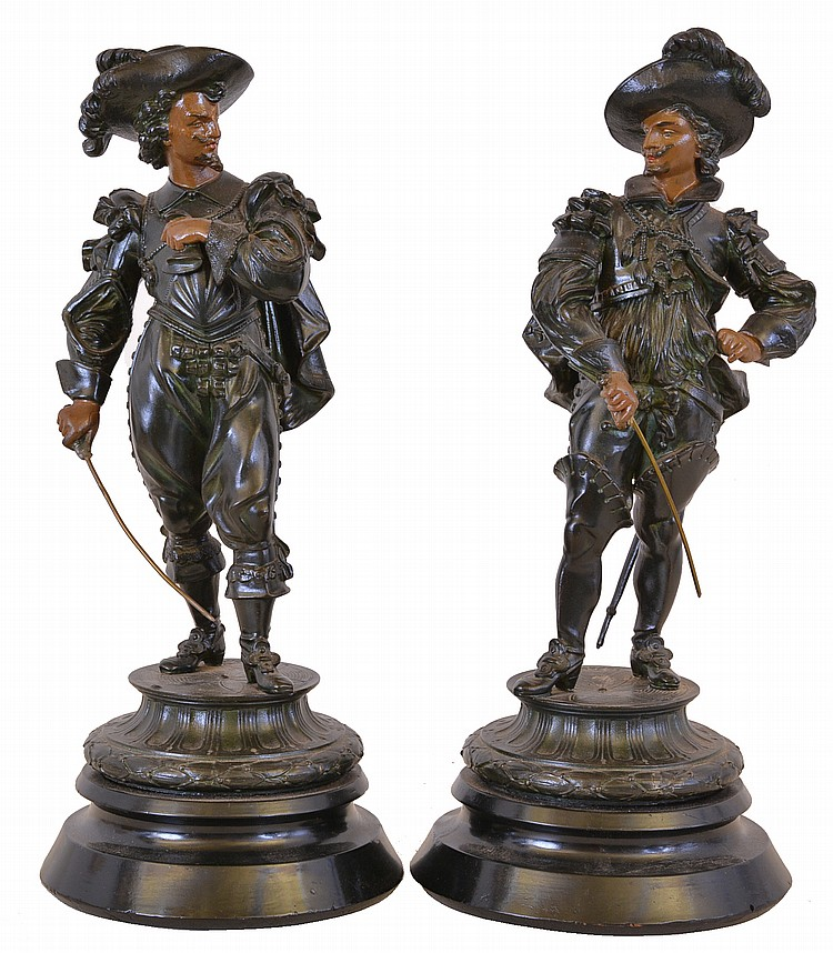 Two cast spelter figures on ebonized wooden bases, probably representing Don Caesar and Don Juan, or two of the musketeers