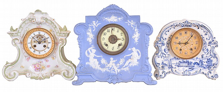 Clocks- 3 (Three): (1) French, Marti & Cie, 8 day, time and strike spring brass movement porcelain mantel clock, c1900 (2) New Haven Clock Co., New Haven, Conn., 8 day, time and strike spring brass movement porcelain mantel clock, c1900 (3) Waterbury