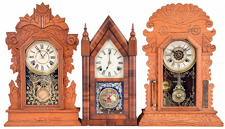 Clocks- 3 (Three): (1) New Haven Clock, New Haven, Conn., 8 day, time and strike spring brass movement Sharp Gothic or Steeple clock, c1875 (2) Waterbury Clock Co., Waterbury, Conn., 8 day, time, strike and alarm spring brass movement shelf clock.
