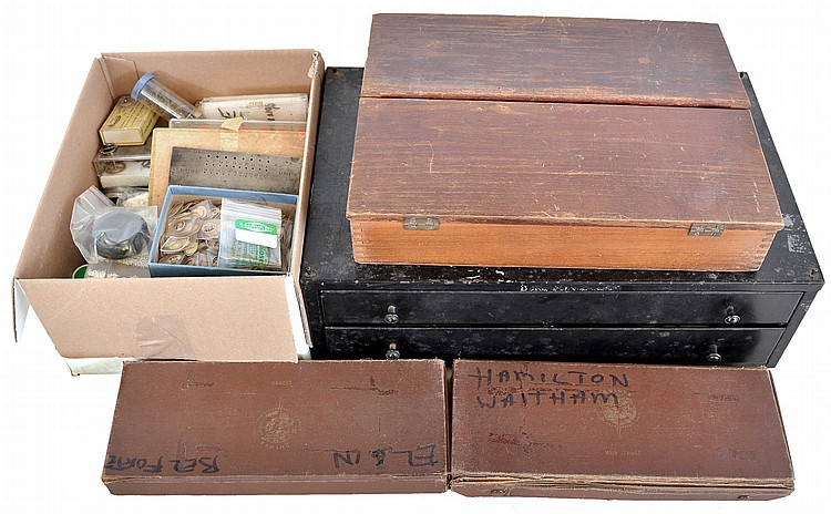 Large lot of crystals and other material, including a wooden cabinet with a substantial number of low dome bullseyes, sizes from 15 3 / 16 to 21 9 / 16, a box of crystals, balances, and misc., and a two drawer cabinet, also with crystals, watch