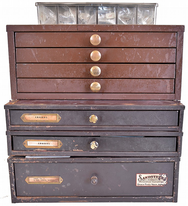 Lot of five cabinets containing mainsprings, crowns, set bridges, screws, hands, and more