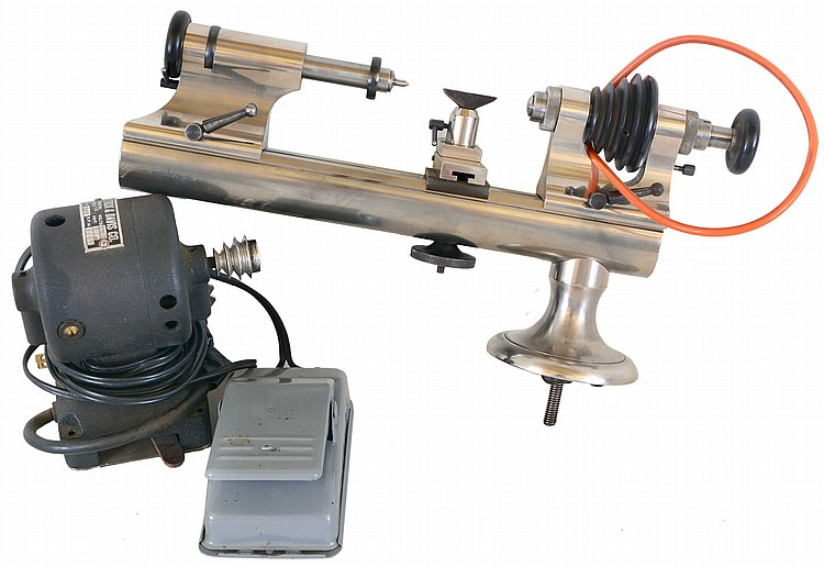 Levin 8 MM watchmakers lathe with plain bearing headstock, collet holding tailstock, and tip over tool rest, with K & D reversing motor, and Foredom variable speed foot control