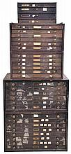 Watch crystals, 7 metal cabinets (4 large, 3 small) with 30 drawers of new / old glass shapes in wristwatch sizes with original stickers