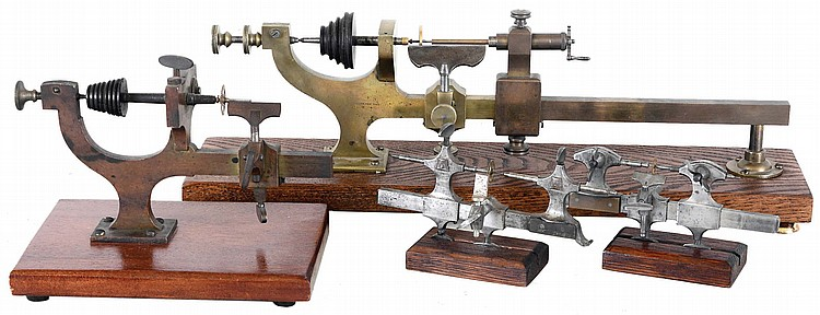 Watchmakers lathes, two 19th century brass wax lathes mounted to boards, one signed