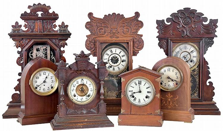 Clocks- 7 (Seven): (1) Waterbury Clock Co., Waterbury, Conn., 8 day, time, strike and alarm spring brass movement shelf clock, c1900 (2) New Haven Clock Co., New Haven, Conn., 8 day, time and strike spring brass movement shelf clock, c1890 (3) E.