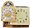 Parts and material including pendulums, dials, bezels, weights, shells, cuckoo bellows, a Howard Miller short drop and a Seth Thomas short drop time only wall clocks, etc.