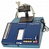 Vibrograph MR600 watch timing machine by Portescap, La Chaux- de- Fonds, Switzerland. Includes power cord and pickup on stand