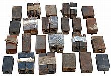 Lifetime collection of 8 day and other assorted large weights, all are cast iron. There are several forms including standard rectangular, tapered pyramidal, etc. Approximately 75 individual weights, including many matched pairs.