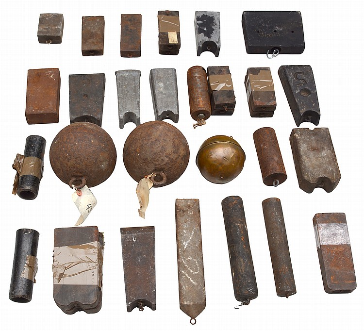 Lifetime collection of banjo, regulator and wafer weighs including a wide variety of different poundage / sizes all in cast iron. Approximately 32 individual weights, including some matched pairs.