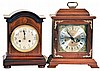 Clocks- 2 (Two): (1) Hamilton Clock Co., 8 day, time and strike Westminster chime spring brass movement bracket clock, c1978 (2) Germany, Junghans, 8 day, time and strike spring brass movement mantel clock, c. 1915.