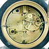 Clocks- 2 (Two) French 8 day time and strike mantel clocks: (1) marble and bronze figural of bearded gentleman reading. Japy movement with countwheel and bell striking; (2) an ornate cast brass case with bell striking movement and white enamel dial