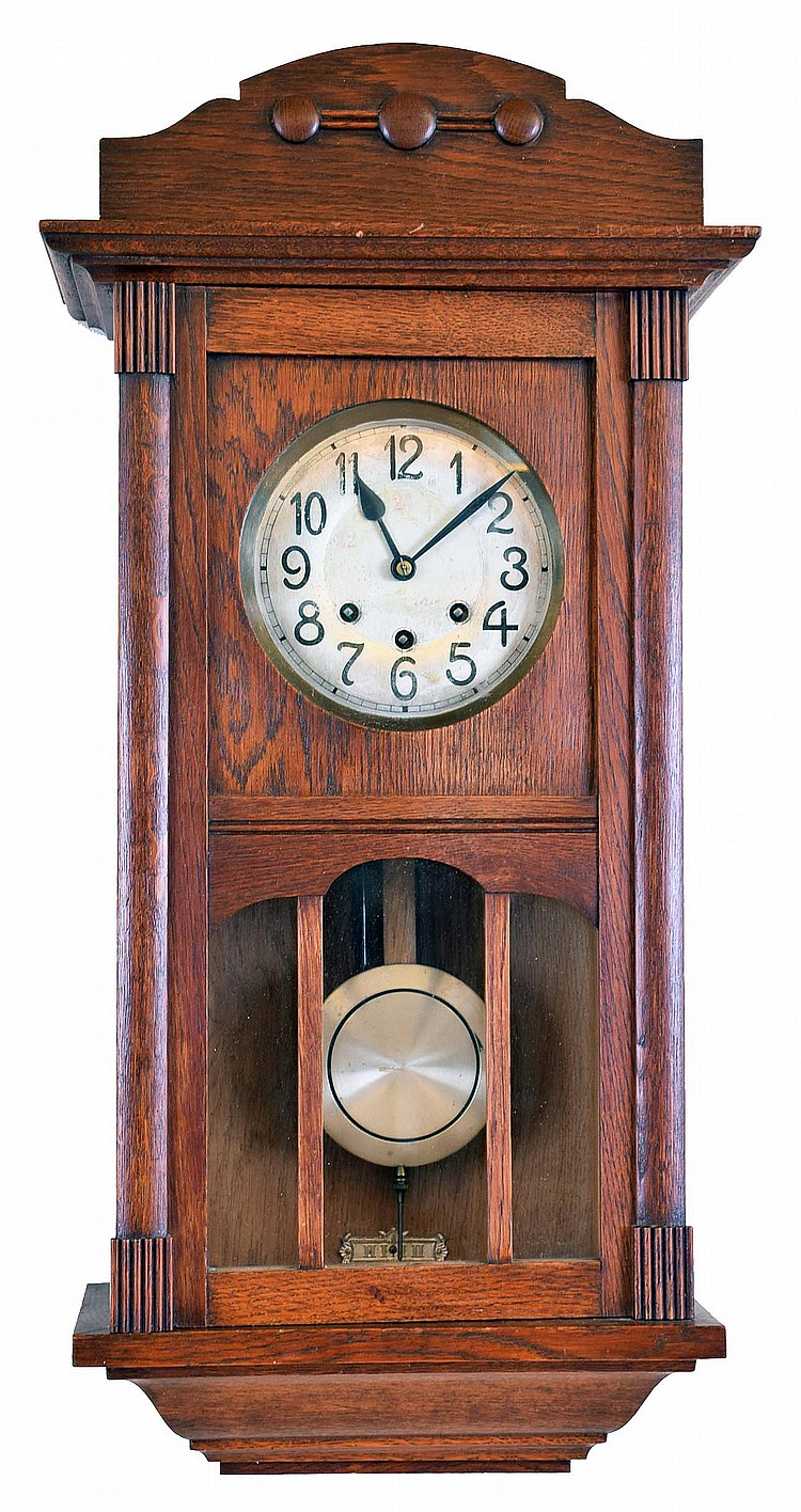 Clocks- 2 (Two) German 8 day wall clocks: unsigned spring wound Westminster chime oak box regulator; Gustav Becker 2 weight time and strike walnut Vienna regulator with signed Medaille- D'Or movement #446242, beveled glass front door panels, matching