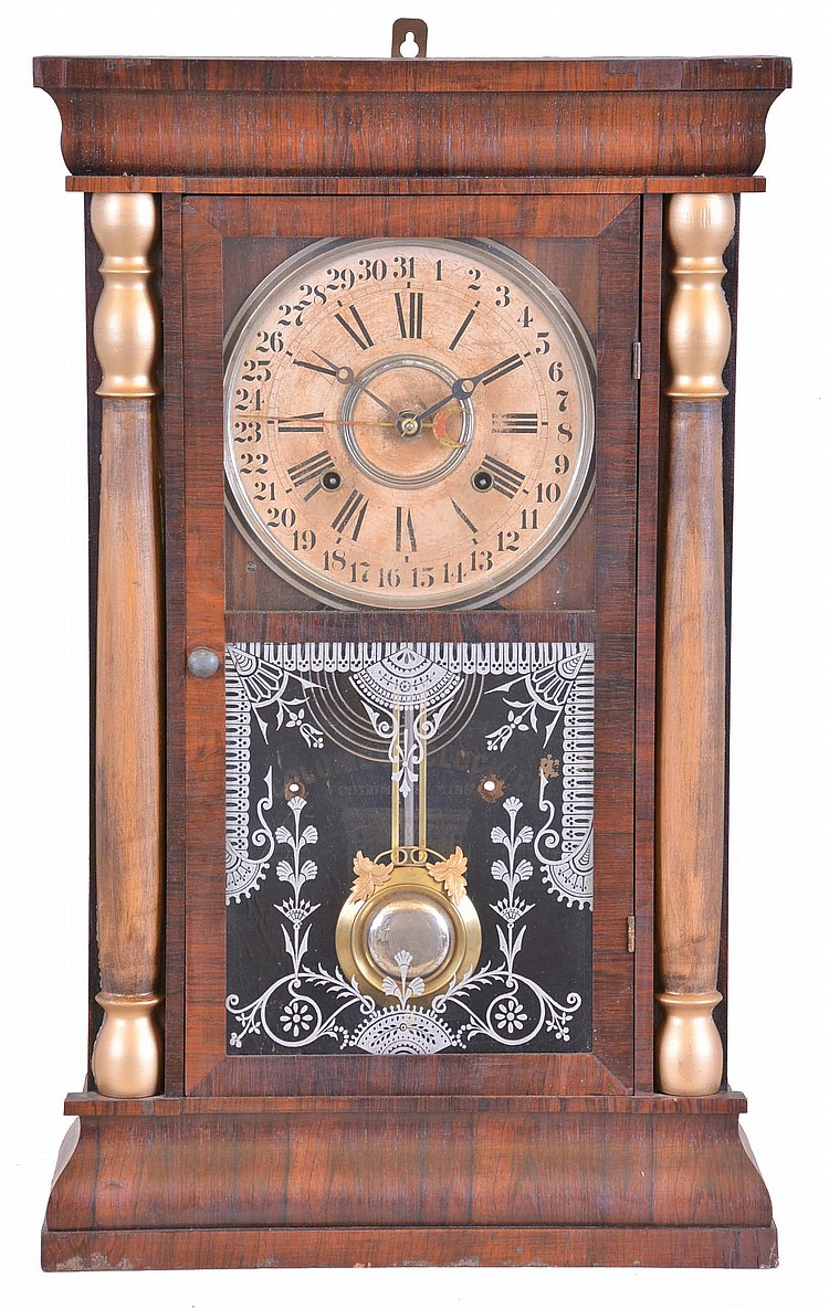 Columbus Clock Co., Columbus, Miss., 8 day, time and strike spring brass movement column calendar clock.