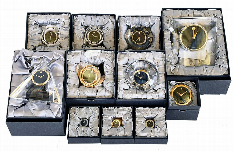 Clocks- 17 (Seventeen) Movado desk clocks, Japanese quartz movements, various models with brass, Lucite, etc., new / old stock in original gift boxes