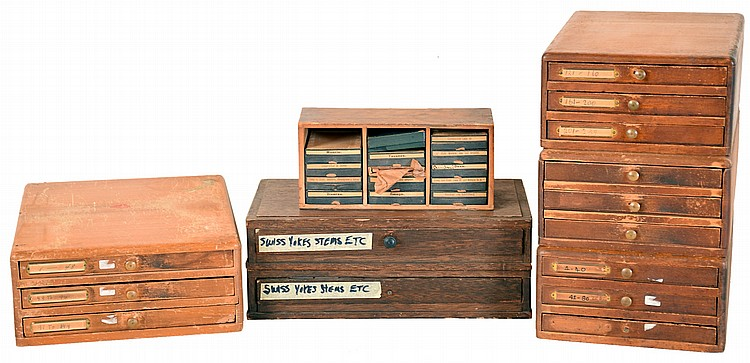 Watch Parts Cabinets- 7 (Seven). Four 3 drawer cabinets with vials containing miscellaneous wrist watch parts, two single drawer cabinets with small boxes containing stems and setting parts, and a small wooden box containing watch hands