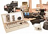 Sherline Model 4000 long- bed lathe with multidirectional milling column, crossslide, fractional watchmaker's collet set, W.R. Smith tool rest, other accessories and tooling, and adjustable wood movement stand