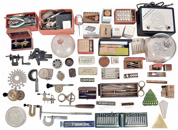 Large lot of watchmakers tools, including a depthing tool, bench micrometer, crown reamers, jewelling tool, metric tap and die set, loupes, tweezers, and more