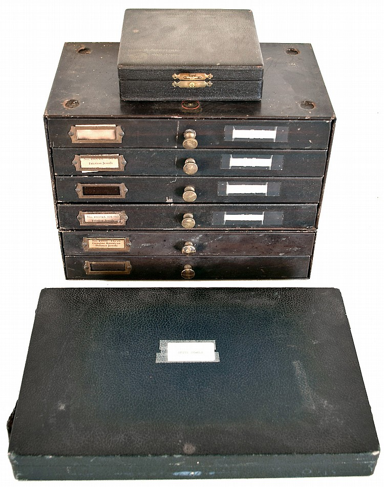 Assortment of jewels, a six drawer Swartchild system metal cabinet and two Seitz friction jewel latched cases with a few miscellaneous of other parts