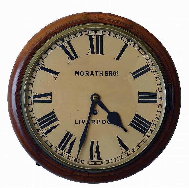 English, 8 day, spring fusee brass movement gallery clock sold by Morath Brothers, Liverpool, England.