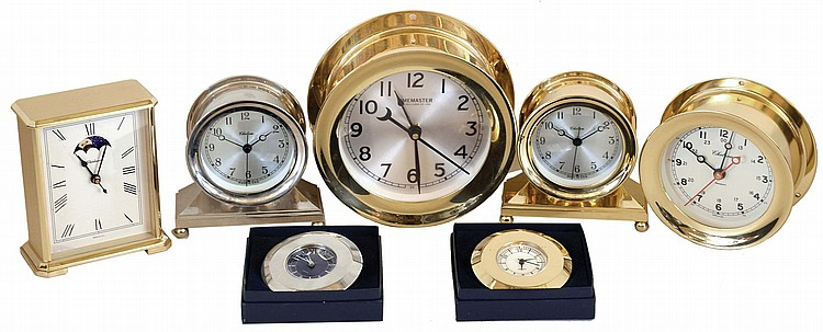 Clocks- 7 (Seven) Chelsea Clock Company metal case quartz movement clocks, new / old stock mostly in original factory packaging: two #20990 Brewster desk clocks in brass and nickel; #20892