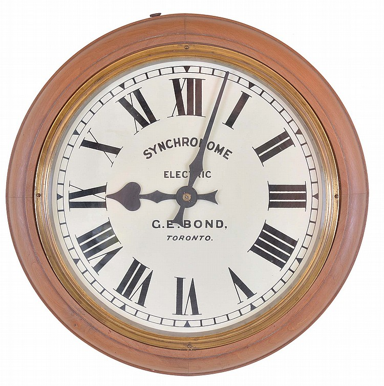 The Synchronome Co., Ltd., England, slave clock, turned cherry case with Roman numeral white painted dial, black painted steel hands