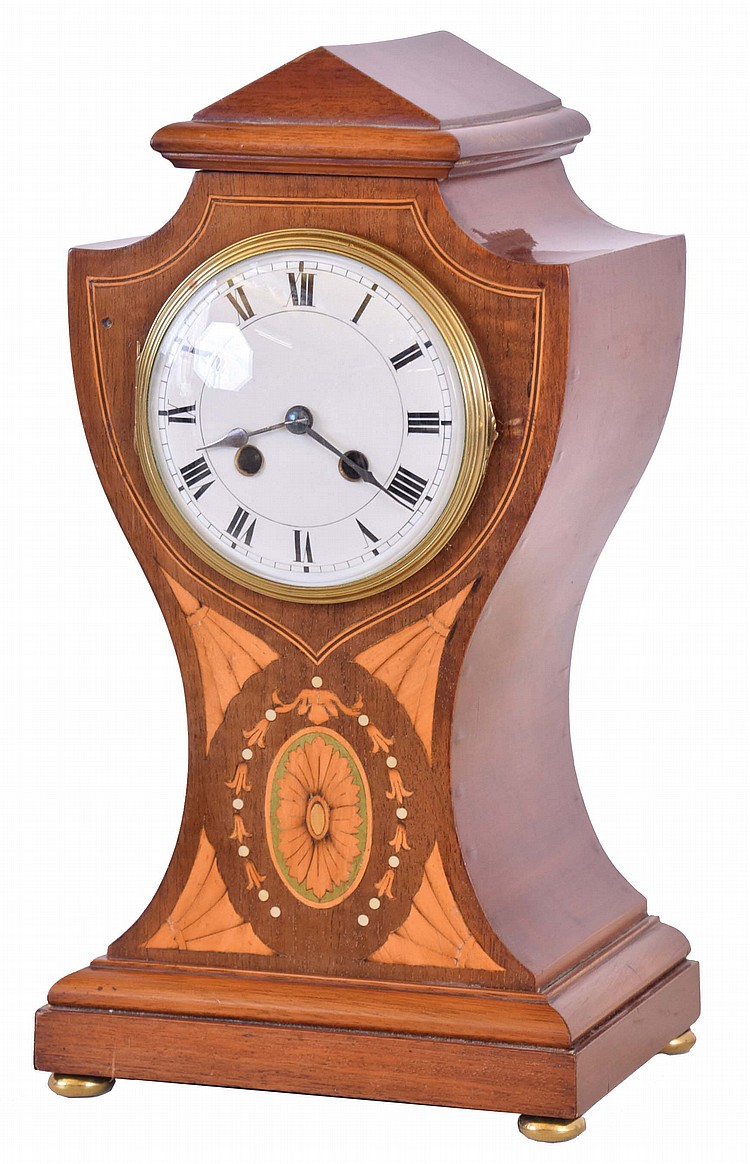 French, 8 day, time and strike spring brass movement inlayed mahogany mantel clock.