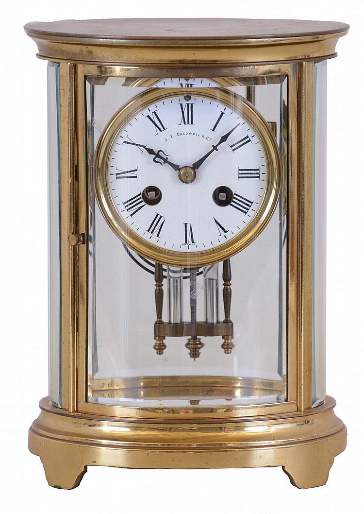 French, CH. Hour, 8 day, time and strike spring brass movement crystal regulator in oval case retailed by J.E. Caldwell & Co.