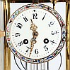French, Marti & Cie, 8 day, time and strike spring brass movement crystal regulator with enameled decoration.