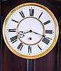 Germany, unsigned Vienna regulator style wall clock, 8 day, time only, weight driven movement in a serpentine style ebonized case with white enamel two part dial.