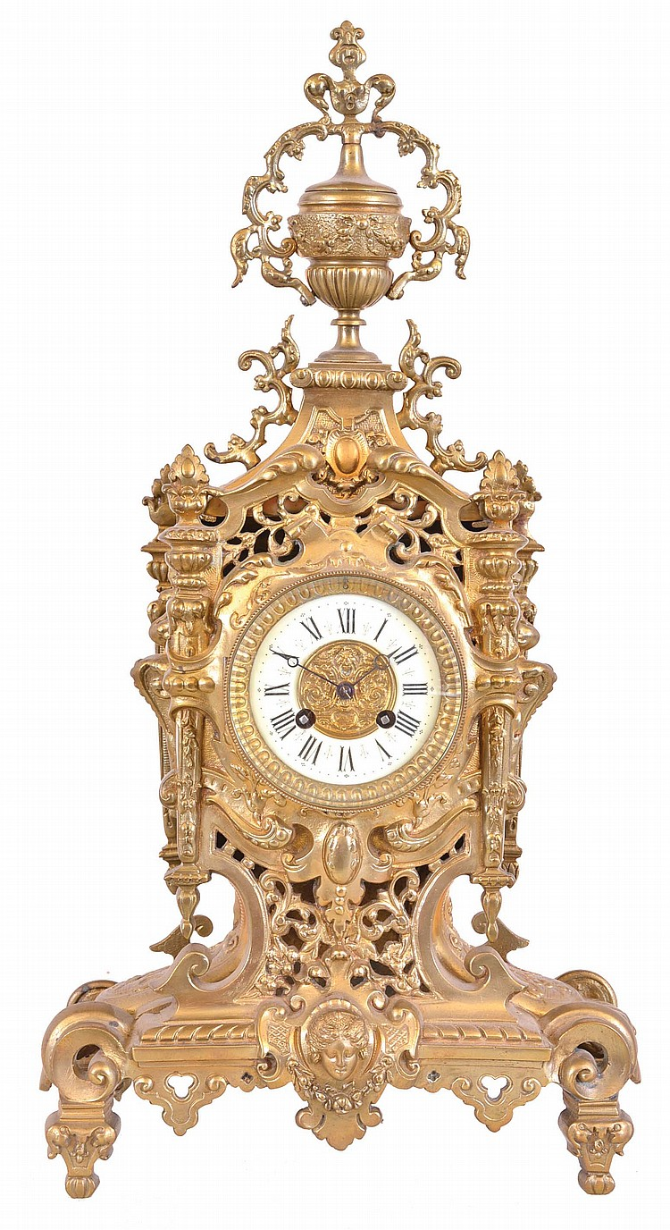 France, mantel clock, the case with piercing and cast ornament, Roman numeral white enamel dial, blued steel Breguet style hands, 8 day time and strike pendule de Paris movement