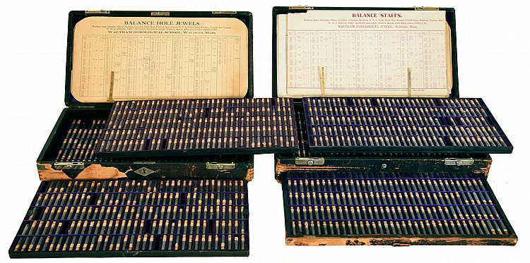 Waltham Horological School watch maker student's parts kit including balance staffs and balance hole jewels with reference charts, the wooden cases have three trays in each kit.