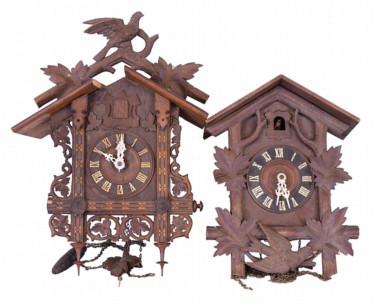 Clocks- 7 (Seven) German Cuckoo two- weight thirty- hour, 5 are larger older examples, 2 are modern