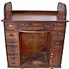 Watchmakers's Bench, antique oak roll top with 17 drawers, lower cabinet, and pull- out center canvas tray